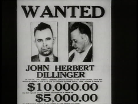 a john dillinger wanted poster advertises rewards for his capture - john dillinger stock-videos und b-roll-filmmaterial