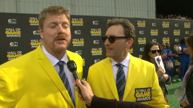 john dimaggio and tom kenny on announcing at the event, on colin kaepernick and cam newton as hosts, favorite sports, on the olympics, and on advice... - barker hangar stock videos & royalty-free footage