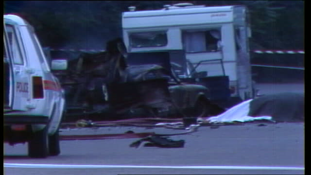 john downey arrested for 1982 hyde park bombing as200782014 / tx ext wreckage of car in which bomb had been placed - ロンドン ハイドパーク点の映像素材/bロール