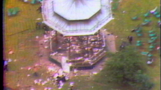 john downey arrested for 1982 hyde park bombing as200782015 / tx regent's park bandstand and casualties on ground following ira bomb attack at... - ロンドン ハイドパーク点の映像素材/bロール