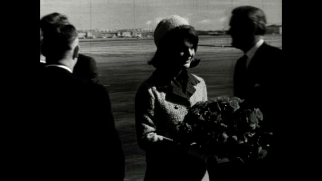 john f kennedy and first lady arrive at love field in texas later in the day the president would be assassinated while riding in his motorcade - john f. kennedy politik stock-videos und b-roll-filmmaterial