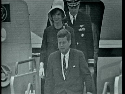 john f kennedy and jackie kennedy arrive in london ***also london lap ext john f kennedy and jackie kennedy from plane and down steps greeted by earl... - jacqueline kennedy stock videos and b-roll footage