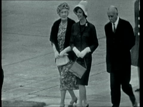 john f kennedy and jackie kennedy arrive in london england london lap john f kennedy along with harold macmillan mp on airport tarmac after arrival... - jacqueline kennedy stock videos and b-roll footage