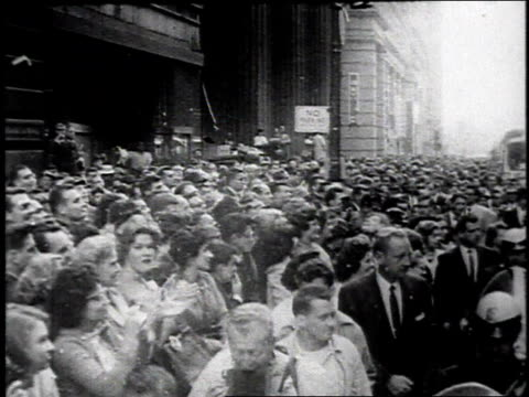 john f kennedy and jackie riding in convertible car in ticker tape parade / united states - john f. kennedy politik stock-videos und b-roll-filmmaterial