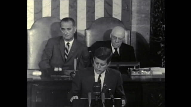 john f. kennedy announces the decision of sending an american safely to the moon / he speaks in front of a special joint session of congress.... - john f. kennedy us president stock videos & royalty-free footage