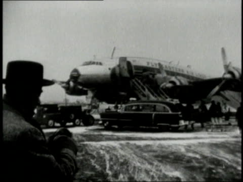 john f kennedy being carried on a stretcher onto an airplane / united states - anno 1954 video stock e b–roll