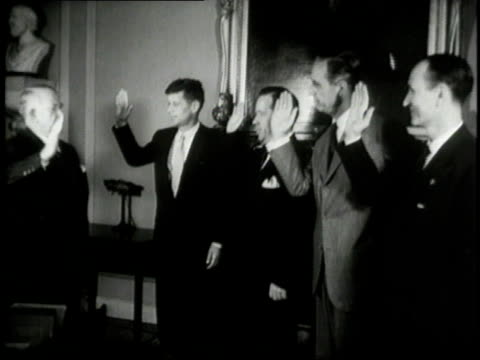 John F Kennedy being sworn as a United States Senator by Alben Barkley / Washington District of Columbia United States