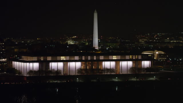 john f. kennedy center for the performing arts at night with washington monument and capitol in background. shot in 2011. - john f. kennedy center for the performing arts stock videos & royalty-free footage