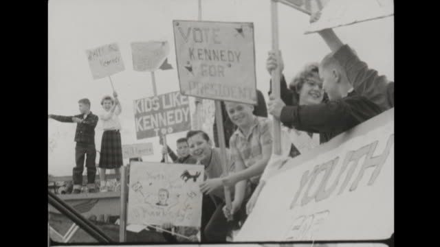 stockvideo's en b-roll-footage met john f kennedy gets off pan american commercial plane in anchorage alaska presidential campaign jokes about moving capital but makes it clear the... - alaska verenigde staten