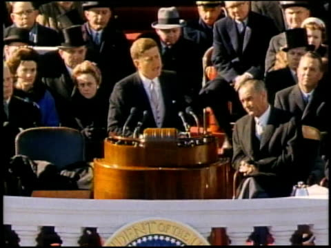 john f. kennedy giving inaugural speech and delivering the line, ask now what your country can do for you... audience watching and applauding /... - john f. kennedy us president stock videos & royalty-free footage
