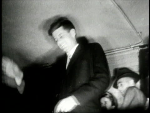 stockvideo's en b-roll-footage met john f. kennedy going into and coming out of a voting booth / boston, massachusetts, united states - 1946