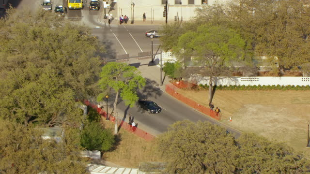 ms aerial pan john f kennedy memorial kill site to sixth floor museum at dealy plaza / dallas, texas, united states - john f. kennedy us president stock videos and b-roll footage