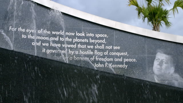 john f kennedy quote on fountain at nasa, cape canaveral - kennedy space center stock-videos und b-roll-filmmaterial