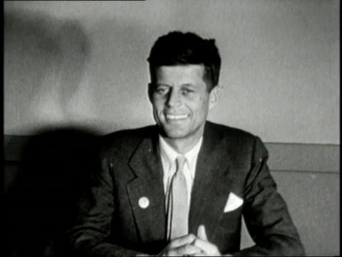 vídeos de stock, filmes e b-roll de john f. kennedy sitting and smiling / united states - 1946