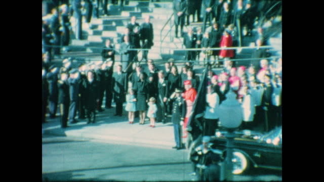 of john f. kennedy's flag draped coffin being led out of the cathedral of st. matthew the apostle by marines. jacqueline kennedy and her children,... - apostle stock videos & royalty-free footage