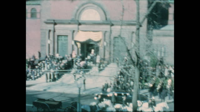 stockvideo's en b-roll-footage met of john f. kennedy's flag draped coffin unloaded from the horse drawn carriage and taken into the cathedral of st. matthew the apostle for the... - apostel