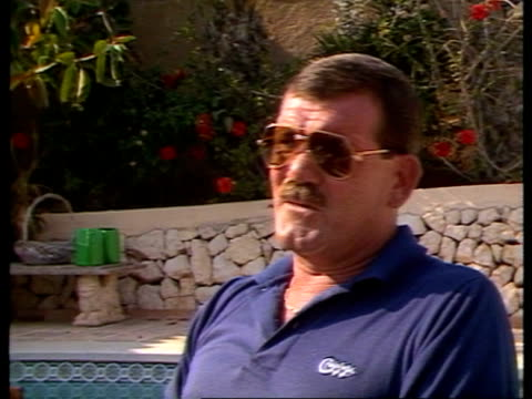 7786 spain costa blanca ms john fleming with bottle of beer in hand lr pan lr as out into pool area to bv ext cms john fleming intvw sof certain... - hand back lit stock videos & royalty-free footage