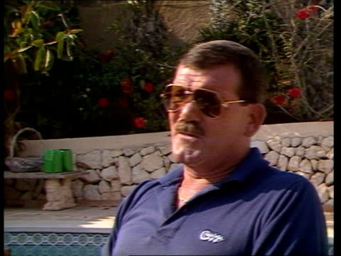 7786 itn spain costa blanca ms john fleming with bottle of bear in hand lr pan lr as out into pool area to bv ext cms john fleming intvw sof certain... - hand back lit stock videos & royalty-free footage