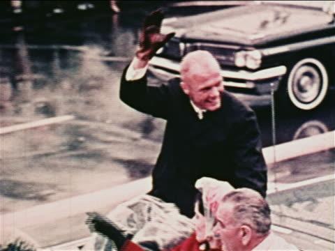 vídeos de stock, filmes e b-roll de john glenn riding in convertible in parade waving / his wife vice president johnson in car - superexposto