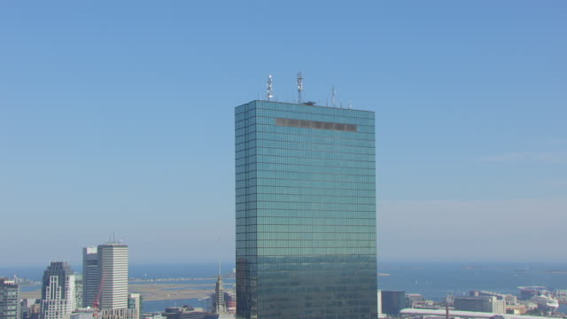WS AERIAL POV John Hancock Tower and Bain Capital with modern cityscape / Boston, Massachusetts, United States