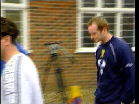 vídeos de stock e filmes b-roll de john hartson along wearing wimbledon fc training kit after 7 and a half million pounds transfer from west ham united fc hartson suit hanging burning... - equipamento de equipa