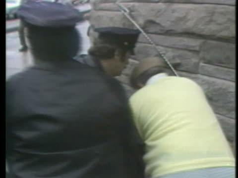 john hinckley attempts to assassinate united states president ronald reagan. - ronald reagan us president stock videos & royalty-free footage