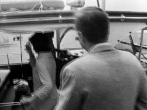 stockvideo's en b-roll-footage met john jacqueline kennedy getting on boat at dock / hyannis port - jacqueline kennedy