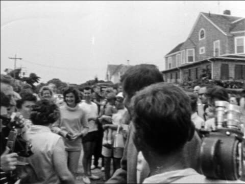 stockvideo's en b-roll-footage met john jacqueline kennedy greeting crowd outdoors / hyannis port massachusetts - jacqueline kennedy