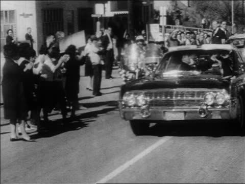 john + jacqueline kennedy riding in convertible in motorcade / dallas / newsreel - john f. kennedy us president stock videos & royalty-free footage