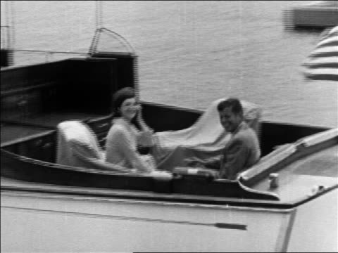 stockvideo's en b-roll-footage met john jacqueline kennedy riding on cabin cruiser pulling away / hyannis port - jacqueline kennedy
