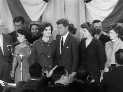 stockvideo's en b-roll-footage met john jacqueline kennedy standing on stage at victory press conference - jacqueline kennedy