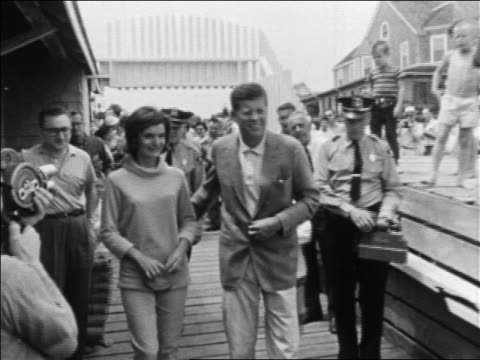 stockvideo's en b-roll-footage met john jacqueline kennedy walking on pier greeting people / hyannis port - jacqueline kennedy