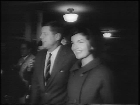 stockvideo's en b-roll-footage met john jacqueline kennedy walking thru crowd to vote indoors / newsreel - jacqueline kennedy