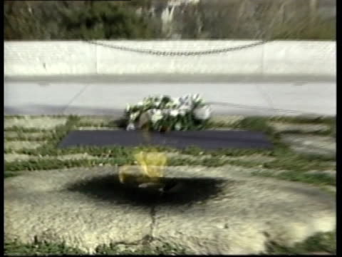 PRES JOHN F KENNEDY SPEECH SOF VOICEOVER ask not what your country can do Kennedy grave ZOOM IN flame