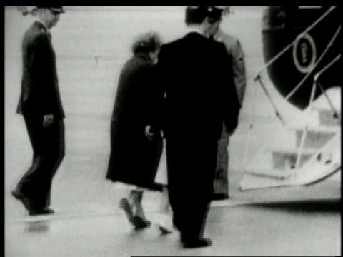 John Kennedy Jr being led to plane accompanied by escort / United States