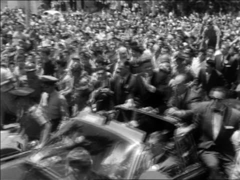 john kennedy riding in convertible with others thru crowd in mexico - john f. kennedy myndighetsroll bildbanksvideor och videomaterial från bakom kulisserna