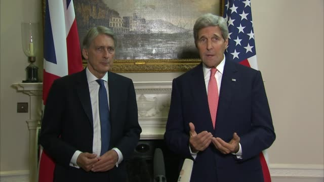 John Kerry and Philip Hammond press conference Hammond and Kerry question and answer SOT Threat posed by ISIL / on low numbers of Syrian refugees...