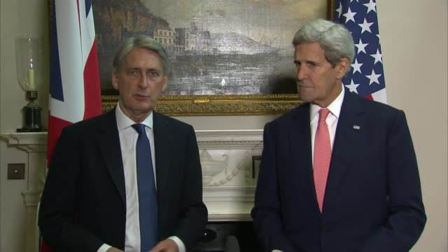 John Kerry and Philip Hammond press conference SKY London Foreign Office INT Philip Hammond MP and John Kerry down stairs and posing for photocall /...