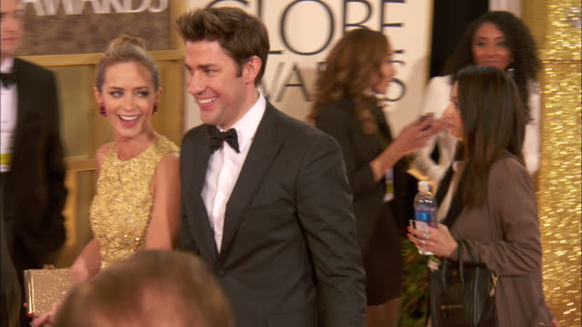 john krasinski and emily blunt walking down the red carpet holding hands at the beverly hilton hotel - john krasinski stock videos and b-roll footage