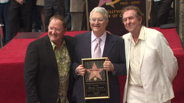 john lasseter , randy newman and eric idle at the randy newman honored with a star on the hollywood walk of fame at hollywood ca. - エリック アイドル点の映像素材/bロール