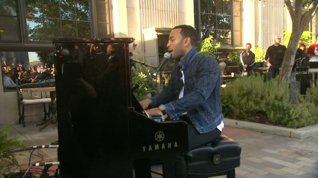PERFORMANCE John Legend at Crackle Launches Playing It Forward With Surprise Street Performance By John Legend Sponsored By Fed Ex in Los Angeles CA