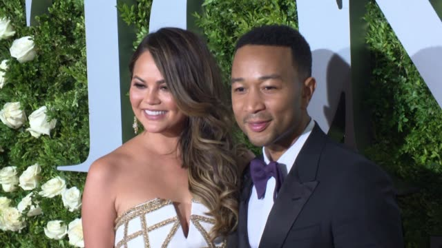 john legend chrissy teigen at 2017 tony awards red carpet at radio city music hall on june 11 2017 in new york city - annual tony awards stock videos & royalty-free footage