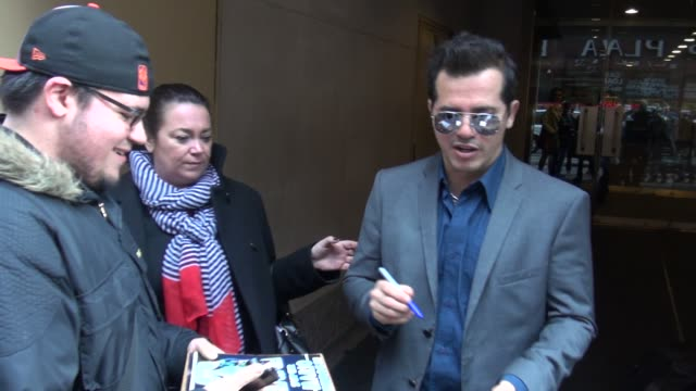 John Leguizamo exits the Today show in Rockefeller Center signs for poses with fans before getting into his car in Celebrity Sightings in New York