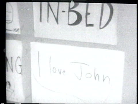 john lennon and new wife yoko ono arrive pair out of car surrounded by media / john and yoko stand in front of media lennon hugs yoko / lennon and... - john lennon stock videos and b-roll footage