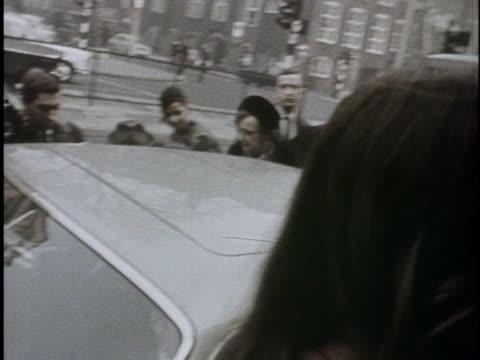 john lennon and yoko ono exit the courthouse where john faced a drug possession charge that would lead to a future ins deportation order against him. - crime or recreational drug or prison or legal trial stock videos & royalty-free footage