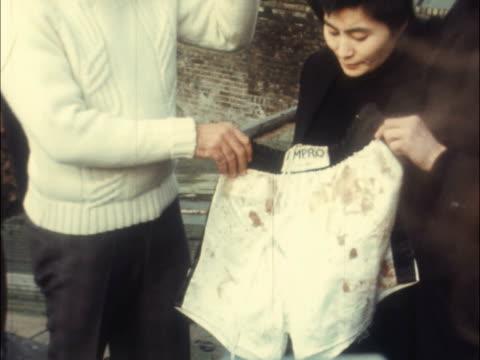john lennon and yoko ono present hair for fundraiser; england: london: holloway roadextms john lennon and yoko ono hand hair to michael x hair - pull... - shorts stock videos & royalty-free footage