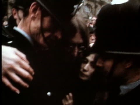 john lennon arrives at the courthouse with yoko ono in gibralter. - music or celebrities or fashion or film industry or film premiere or youth culture or novelty item or vacations stock videos & royalty-free footage