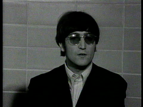 vídeos de stock, filmes e b-roll de john lennon interviewed / he says 'people are entitled not to like us and we have the right to not to regard them if we don't want to' john lennon... - 1966