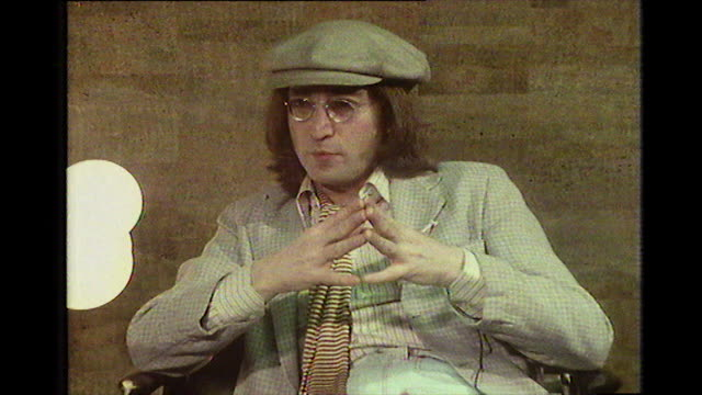 john lennon, speaking in 1975, discussing how he felt the fbi were tapping his phone and keeping him under surveillance in the wake of his... - anno 1975 video stock e b–roll
