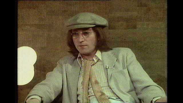 "john lennon, speaking in 1975, on being open to a beatles reunion: ""if somebody wants to pull it together, i'll go along. i'm not in the mood to pull... - anno 1975 video stock e b–roll"